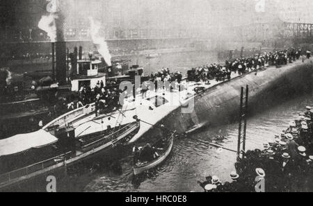 View of Eastland taken from south side of river, shortly after accident, showing the rescuers anxiously at work. - Stock Photo