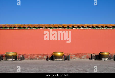 Red Wall and Golden Tank in Forbidden City - Stock Photo
