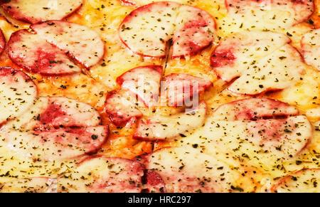 Pizza background close-up macro shot of pepperoni pizza - Stock Photo