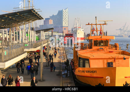 Hamburg, Germany - Februar 15, 2017: Harbor ferries waiting at the Landungsbruecken (landing bridges) for passengers - Stock Photo