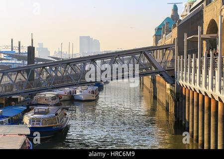 Hamburg, Germany - Februar 15, 2017: Famous sight of Hamburg, the Landungsbruecken, at the elbe river with small - Stock Photo