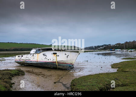 remains boat abandoned beached Gannel Estuary gloomy overcast day Newquay Cornwall UK weather - Stock Photo