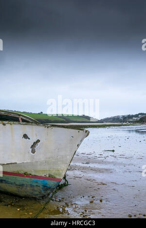 prow remains boat abandoned beached Gannel Estuary gloomy overcast day Newquay Cornwall UK weather - Stock Photo