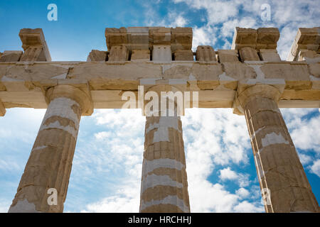 Detail of the old Doric columns at the Acropolis, Athens with a close up view of three of them looking up to the - Stock Photo