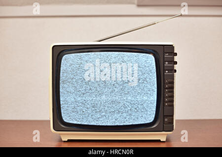 Small retro Black and white Television with no signal. - Stock Photo