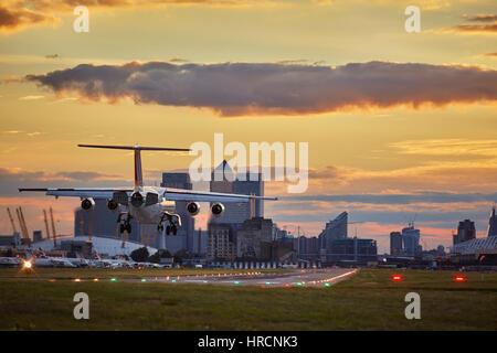 Landing Plane on London City Airport - Stock Photo