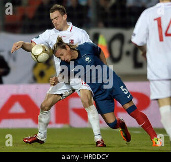 Aurelien Joachim (L) of Luxembourg fights for the ball with Philippe Mexes (R) of France during the EURO 2012 Group - Stock Photo