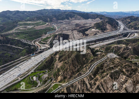 Aerial view of the Golden State 5 Freeway, Los Angeles Aqueduct and Sunshine Canyon Landfill near Santa Clarita, - Stock Photo