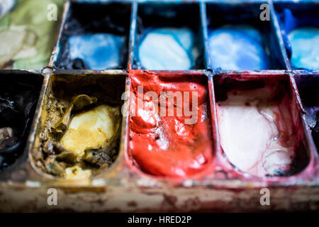 Watercolor Palette. Red, Yellow oak,cobalt blue,black,violet,purple,indigo.Close up and macro. - Stock Photo