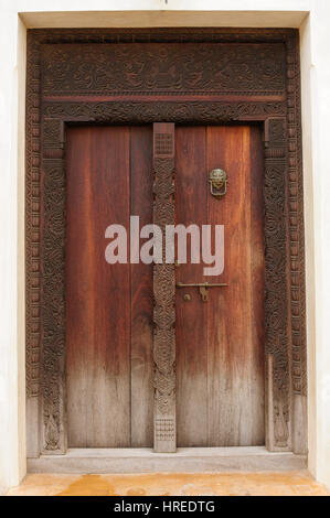 Traditional carved wooden door in Lamu Town, Kenya - Stock Photo