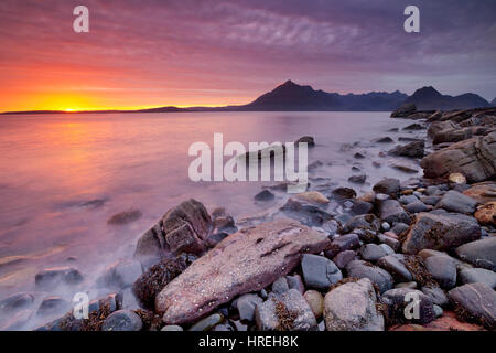 The beach of Elgol on the Isle of Skye, Scotland with The Cuillins in the background. Photographed at sunset. - Stock Photo
