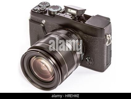 Modern retro mirrorless Digital Camera Isolated On White Background - Stock Photo