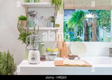 Interior of modern kitchen with blender, block, knife and kitchen appliance in house. - Stock Photo