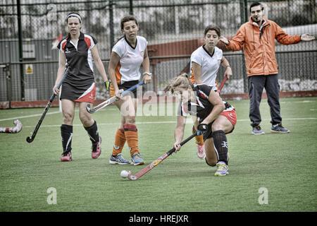 Gibraltar Hockey - Grammarians HC playing friendly against San Fernando HC from Cadiz. - Stock Photo
