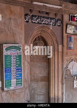 Prayer times, known as Salah, listed in the sixteenth century Siddi Sayed mosque in the old city of Ahmedabad in - Stock Photo