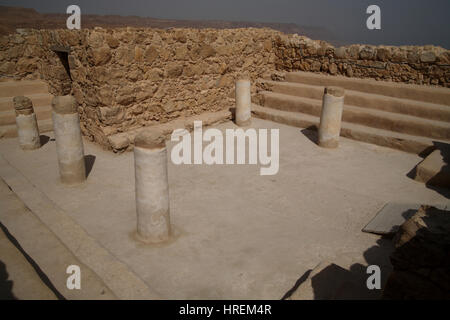 A building with columns and benches built by King Herod the Great and turned to a synagogue by the rebels in the - Stock Photo