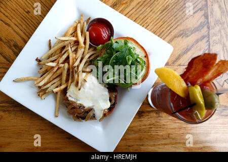 Bison Bistro Burger and fries with Bacon Bloody Mary, Dining Hall, Chautauqua Park, Boulder, Colorado USA - Stock Photo