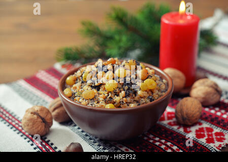 Traditional Christmas slavic dish kutia in ceramic bowl with fir tree - Stock Photo