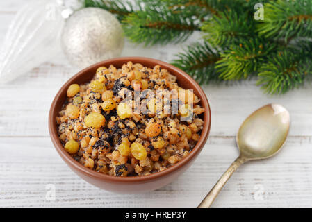 Traditional Christmas slavic dish with boiled wheat, raisins, nuts and honey - Stock Photo