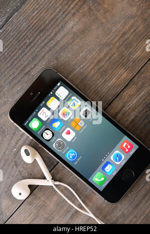 KIEV, UKRAINE - JANUARY 29, 2015: Brand new black Apple iPhone 5s, designed and developed by Apple Inc., it was - Stock Photo