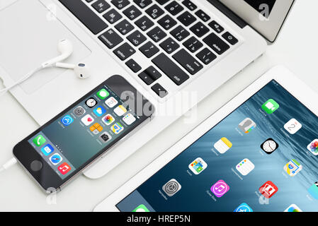 KIEV, UKRAINE - JANUARY 29, 2015: Apple iPhone 5s, iPad Air 2 and MacBook Air. Apple Inc. is an American multinational - Stock Photo