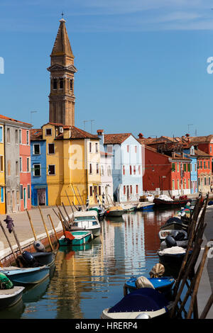 Burano an island of multi colored homes on canals north of Venice Italy - Stock Photo
