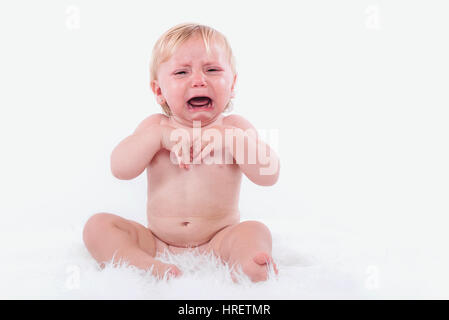 crying baby in diaper - Stock Photo