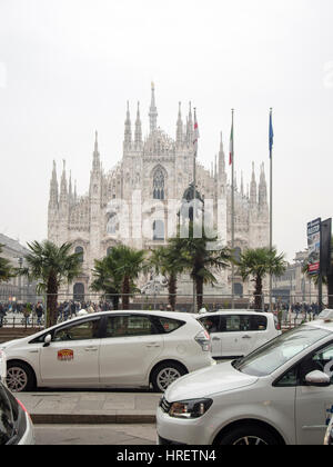 Starbucks palms in Milan, and taxi drivers protesting against uber inPiazza Duomo, during Milano Fashion Week - - Stock Photo