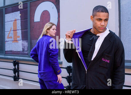 EDITORIAL USE ONLY Andrew Christopher and Stephanie Townrow wear ÔSwitch SuitsÕ, reversible onesies, - Stock Photo