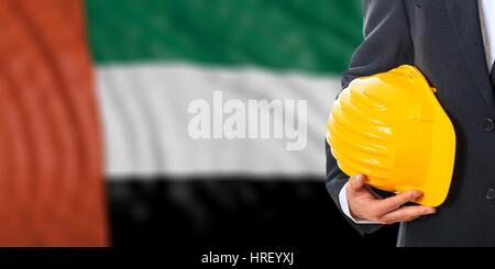Engineer on a waiving United Arab Emirates flag background. 3d illustration - Stock Photo