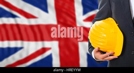 Engineer on a waiving United Kingdom flag background. 3d illustration - Stock Photo