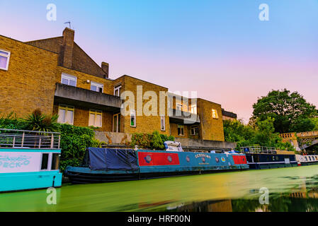 LONDON - JULY 16, 2016: Riverside apartments with boat homes at night along the Regents Park canal which is a famous - Stock Photo
