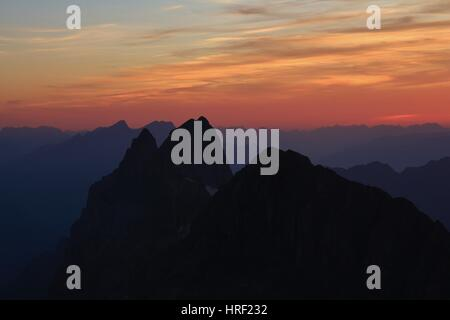 Colorful sunset in the Swiss Alps, view from mount Titlis. Summer scene. - Stock Photo