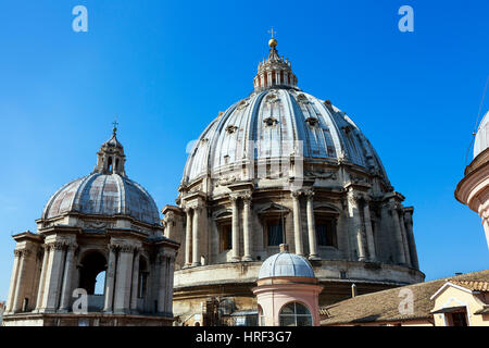Dome of St Peters Basilica with tourists on the top viewing platform, Vatican City, Rome, Italy - Stock Photo