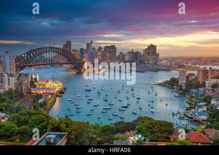 Sydney. Cityscape image of Sydney, Australia with Harbour Bridge and Sydney skyline during sunset. - Stock Photo