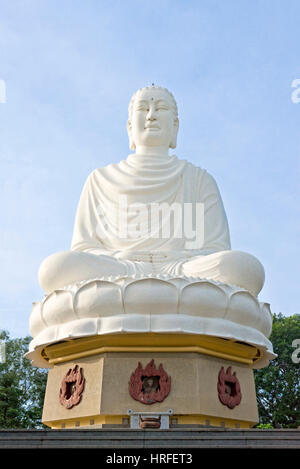 The Gautama Buddha near the Hai Duc Pagoda that sits on top of a hill overlooking Nha Trang on a sunny day with - Stock Photo