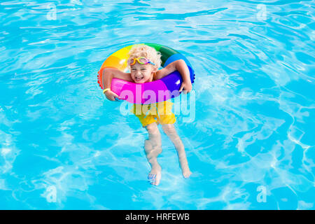 Child Playing With Floating Toys In Pool Stock Photo Royalty Free Image 47838622 Alamy