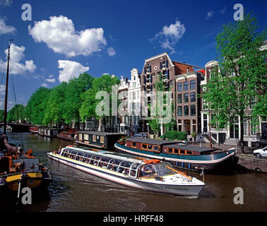 Tourists on a pleasure boat sailing on Brouwersgracht, Amsterdam Holland, Netherlands. - Stock Photo