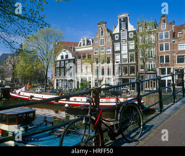Bicycle on a canal bridge, Amsterdam, Holland, Netherlands. - Stock Photo