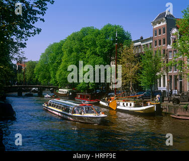 Tourists on a pleasure boat sailing on Brouwersgracht, Amsterdam, Holland, Netherlands. - Stock Photo