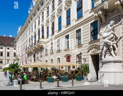Cafe in front of the Reichskanzleitrakt (Imperial Chancellory Wing) in the Internal Castle Square, Hofburg Palace, - Stock Photo