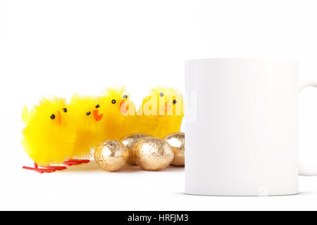 Coffee mug mockup next to yellow fluffy toy easter chicks. Perfect for Easter mugs. Overlay your custom quotes and - Stock Photo