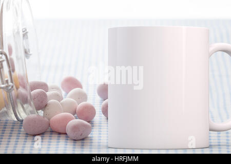 Coffee Mug mockup, chocolate mini eggs in a glass jar, tipped over. Perfect for Easter mugs. Overlay your custom - Stock Photo