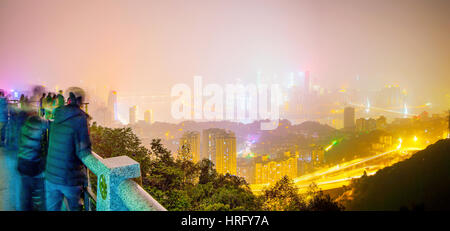 CHONGQING, CHINA - DECEMBER 31: This is a panoramic view of Chongqing taken from Yikeshu mountain where many tourists - Stock Photo
