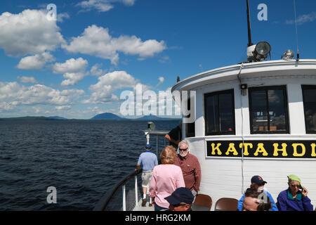 Day trip passengers taking a cruise on Moosehead Lake aboard the Century-old Motor Vessel Katahdin - Stock Photo