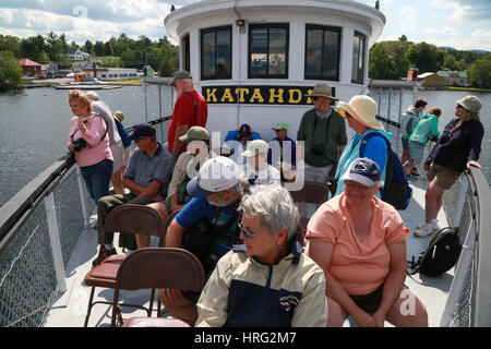 Day trip passengers taking a cruise on Moosehead Lake aboard the Century-old Motor Vessel Katahdin - Stock Photo