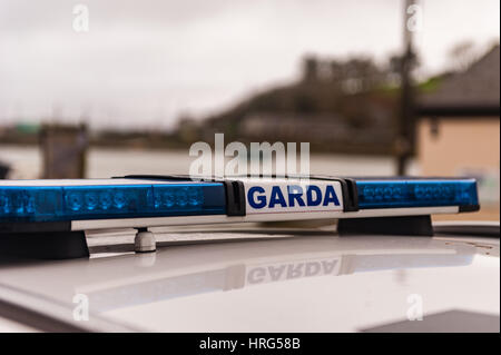Garda/Irish Police sign and blue lights on a Garda/Police car with copy space. - Stock Photo