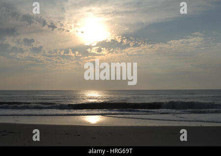 Sunrise over the Atlantic Ocean waves and surf on the beach in Outer Banks, North Carolina - Stock Photo