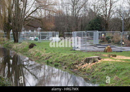 Roath, Cardiff, UK. 1st Mar, 2017. Residents in Roath and Penylan have spoken out against the cutting down of 145 trees. The tree felling is taking place in four gardens along Roath Brook as part of new flood defence work, as here in Railway Gardens. Local people have been leaving 'sympathy' cards and notes of protest on fencing around the sites. Credit: Craig Redmond/Alamy Live News