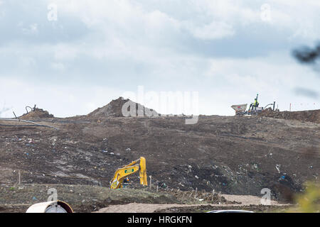Workmen on Wednesday March 1st at Milton landfill site near Cambridge continuing to prepare the ground for the police - Stock Photo